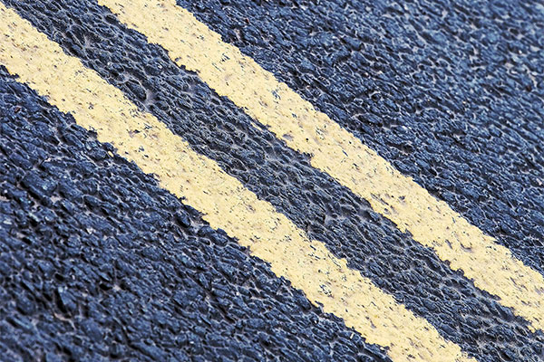 yellow lines on asphalt surface