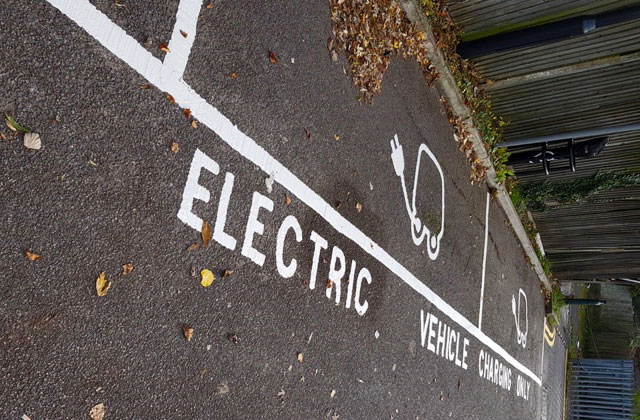 text road marking for electric vehicles